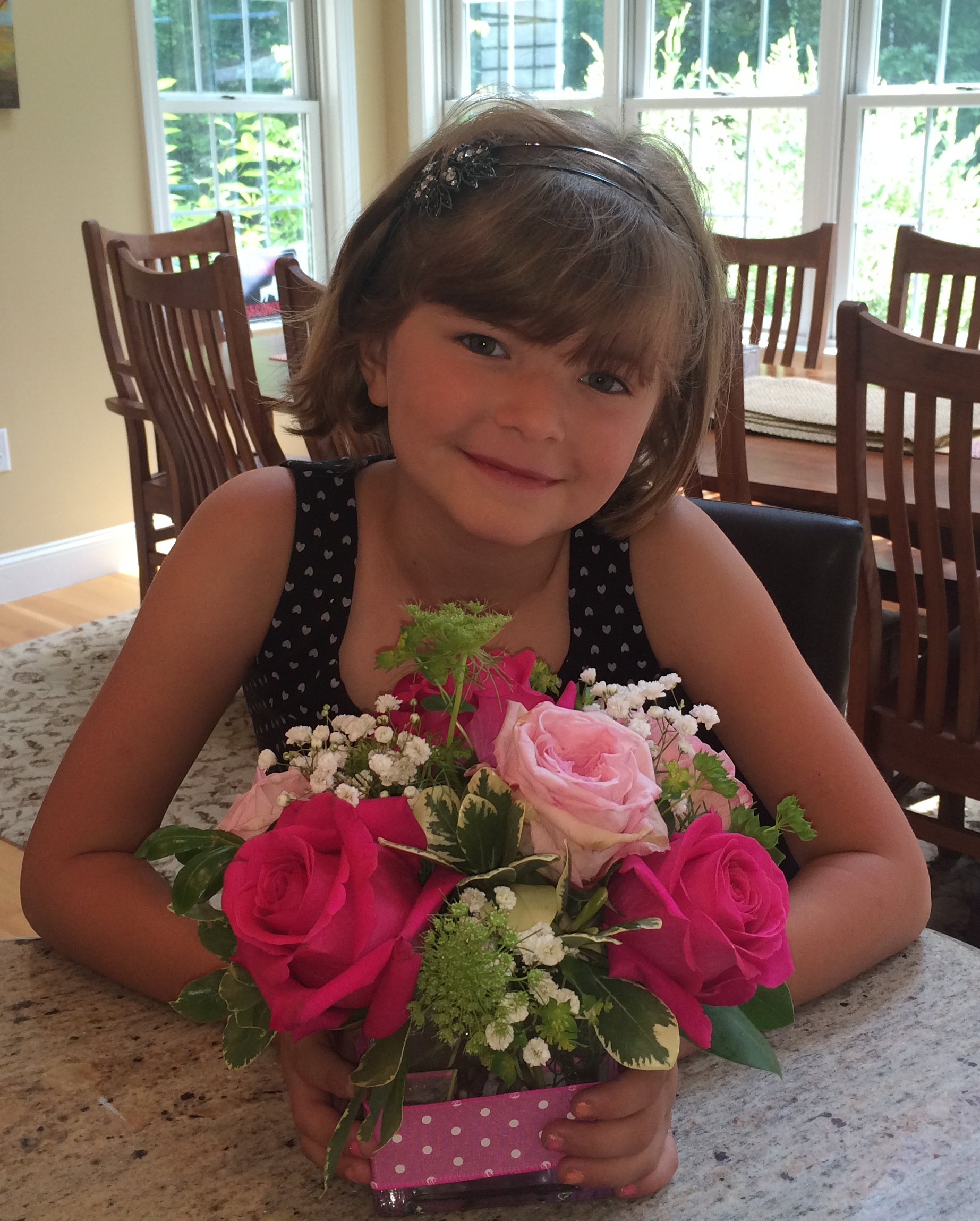 Rose and her birthday flowers.